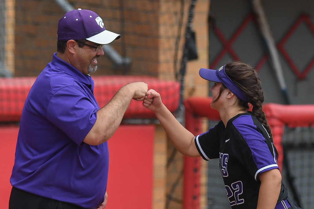 . Eric Bonzar�The Morning Journal<br> Keystone infielder Brooke Piazza gets a fist bump from her father, and head coach Jim Piazza, before the start of the Wildcats\' D-II state semifinal game against the Fairfield Union Falcons, May 31, 2018.