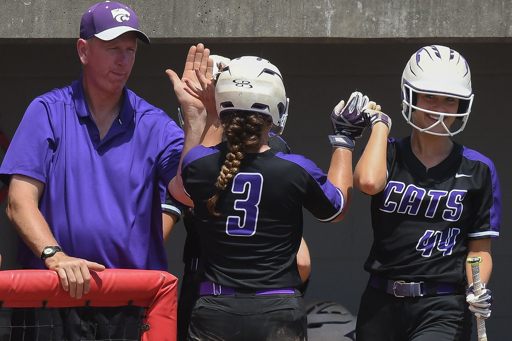. Eric Bonzar�The Morning Journal<br> Keystone\'s Madi Herrington (3) gets a pair of high fives as she returns to the dugout after scoring the Wildcats\' first and only run in the game, May 31, 2018.
