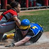 Eric Bonzar—The Morning Journal<br /> Elyria freshman catcher Maycee Godbolt tags Gahanna Lincoln's Kristen Zink out at home plate in the top of the seventh inning.