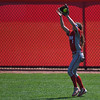 Eric Bonzar—The Morning Journal<br /> Elyria center fielder Macy Taylor snags a fly ball  in the top of the fifth inning.