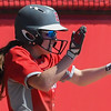 Eric Bonzar—The Morning Journal<br /> Elyria center fielder Macy Taylor celebrates after scoring in the bottom of the fourth inning.