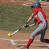 Eric Bonzar—The Morning Journal<br /> Elyria's April Howser singles in the bottom of the first inning.