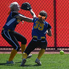 Eric Bonzar—The Morning Journal<br /> Gahanna Lincoln's Lauren Woodward (35) and Lauren Ringhiser collide while attempting to field a fly ball in left field.