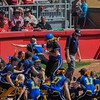 Eric Bonzar—The Morning Journal<br /> The Gahanna Lincoln Golden Lions celebrate Addie Kittel's first of two home runs, in the top of the fourth inning. Kittel also homered in the sixth.