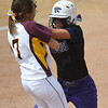 Eric Bonzar—The Morning Journal<br /> Keystone's Summer Constable runs into Ross' Ashley Parrett after being caught in a run down in the bottom of the third inning, June 3, 2016.