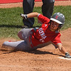 Eric Bonzar—The Morning Journal<br /> Elyria's April Howser scores the tying run in the bottom of the seventh inning.