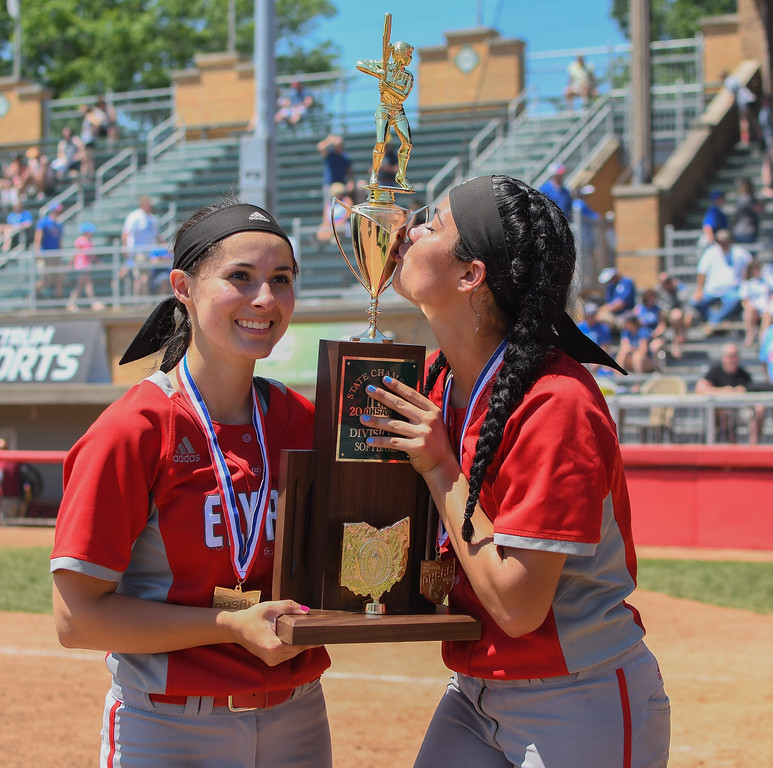 . Eric Bonzar�The Morning Journal Elyria\'s Dierra Hammons gives the trophy a kiss after the Pioneers are crowned the D-I state champions, June 3, 2017. Hammons is pictured alongside fellow senior Madison Cruzado.