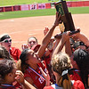 Eric Bonzar—The Morning Journal<br /> The Elyria Pioneers raise the team's D-I state championship trophy after defeating the Lebanon Warriors, 4-3, June 3, 2017.