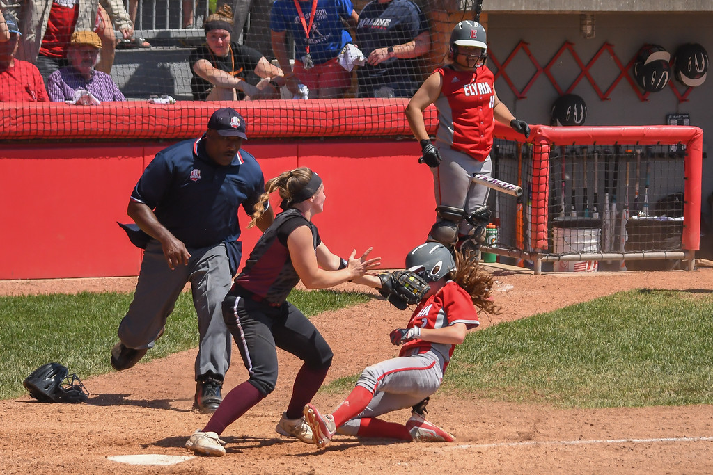 . Eric Bonzar�The Morning Journal Elyria\'s Macy Taylor is tagged at home plate by Lebanon catcher Molly Osborne in the bottom of the seventh. An interference call at third base reversed the call, giving the Pioneers the run and a 4-3 D-I state championship win over the Warriors.