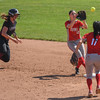 Eric Bonzar—The Morning Journal<br /> Lebanon's Grace Gressly is out at second as Elyria's Dierra Hammons tosses to Madison Cruzado (12).