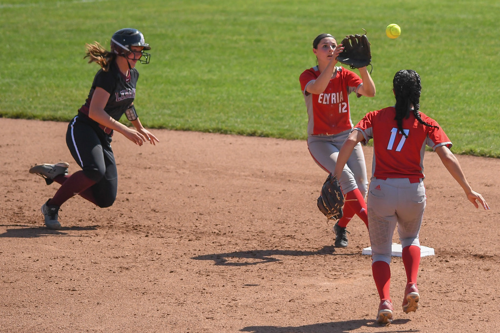 . Eric Bonzar�The Morning Journal Lebanon\'s Grace Gressly is out at second as Elyria\'s Dierra Hammons tosses to Madison Cruzado (12).