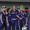 Eric Bonzar—The Morning Journal<br /> Keystone 's Lauren Shaw, middle, and her fellow teammates are all smiles after dropping the D-II state semifinal game against the Akron Hoban Knights, June 2, 2017.