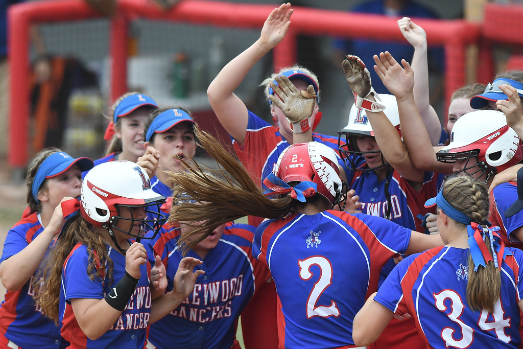 . Eric Bonzar�The Morning Journal Herbron Lakewood\'s Kaitlyn Peacock is mobbed at home plate by her teammates after hitting a three-run home run in the second inning, June 4, 2016.