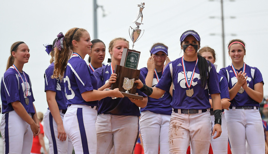 . Eric Bonzar�The Morning Journal The Keystone Wildcats hoist the OHSAA DII State runner-up trophy after falling to the Hebron Lakewood Lancers 7-4, June 4, 2016.