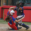 Eric Bonzar—The Morning Journal<br /> Lakewood's Kaitlyn Peacock is out at home as she tries to slide under Keystone catcher Destiny Weber, in the seventh inning, June 4, 2016.