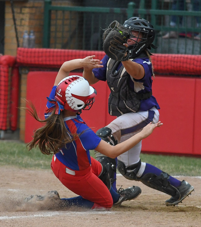 . Eric Bonzar�The Morning Journal Lakewood\'s Kaitlyn Peacock is out at home as she tries to slide under Keystone catcher Destiny Weber, in the seventh inning, June 4, 2016.