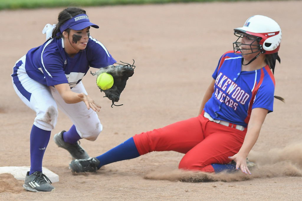 . Eric Bonzar�The Morning Journal Lakewood\'s Courtney Knepper slides into second base safe after Keystone\'s Kodi Akers can\'t hang on to the ball, in the top of the second inning, June 4, 2016.
