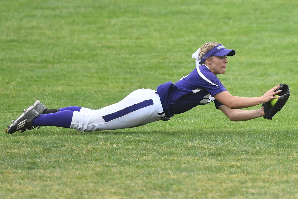 . Eric Bonzar�The Morning Journal Keystone\'s Paige Hartley lays out for a fly ball, in the top of the first inning, June 4, 2016.