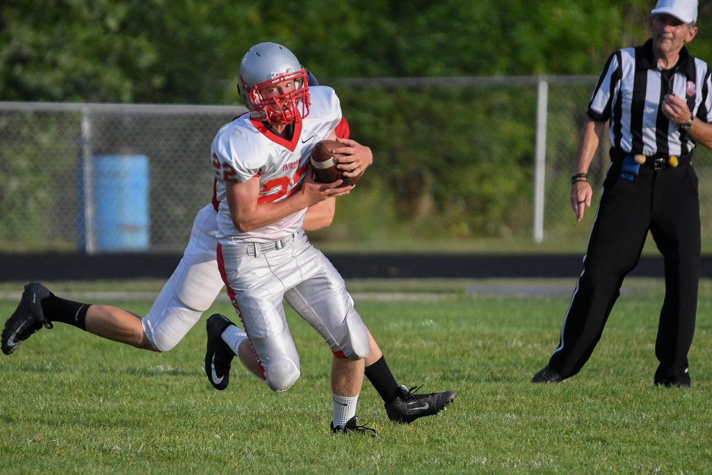 . Eric Bonzar�The Morning Journal Fairview quarterback Jeremy Sassano (22) sheds a tackle as he scrambles out of the pocket.