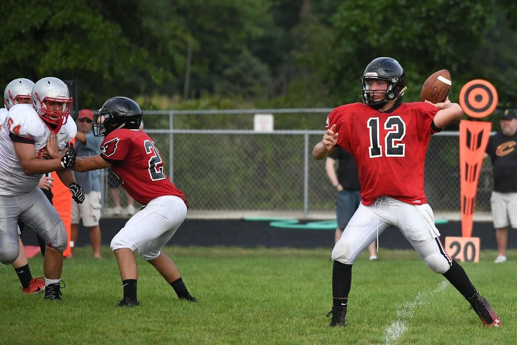. Eric Bonzar�The Morning Journal Brookside quarterback Johnathan Hice (12) drops back to pass.
