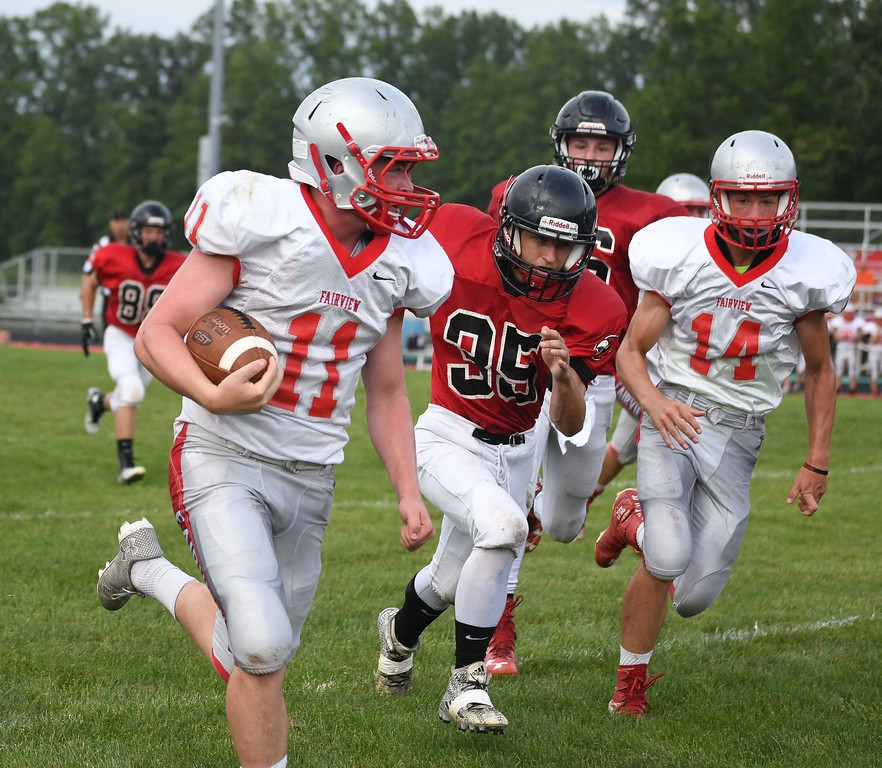 . Eric Bonzar�The Morning Journal Fairview\'s Tommy McNamara (11) runs up the Brookside sideline after an interception.