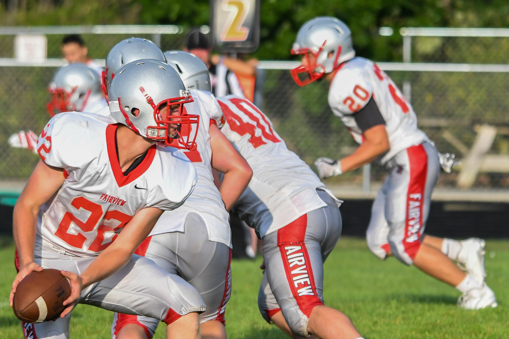 . Eric Bonzar�The Morning Journal Fairview quarterback Jeremy Sassano (22) pitches the football to his running back.