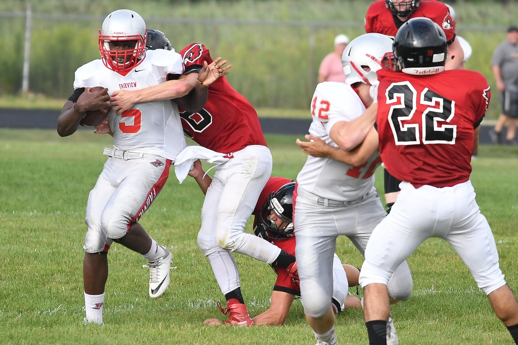 . Eric Bonzar�The Morning Journal Fairview running back Demetrius Allen (5) rushes for a small gain.