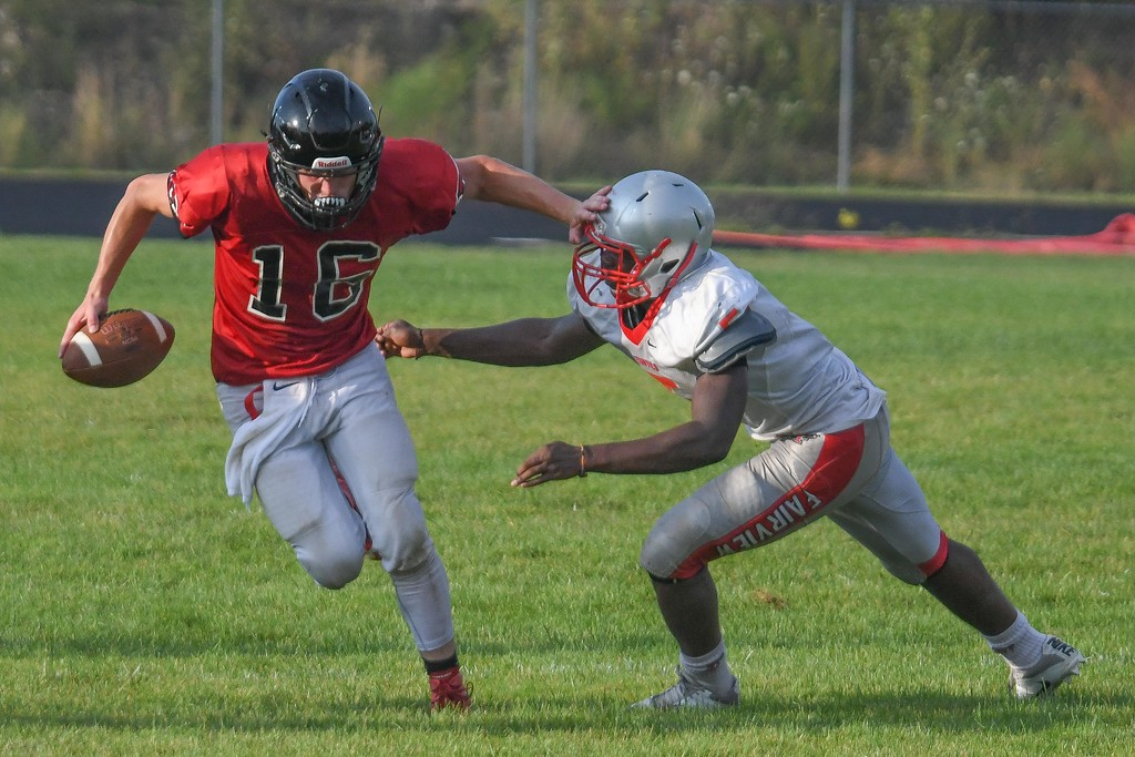 . Eric Bonzar�The Morning Journal Brookside\'s David Chambers (16) stiff arms his way past Fairview\'s Demetrius Allen (5).