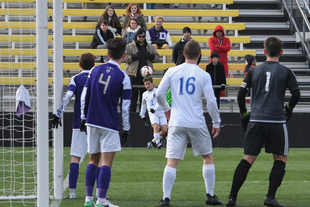 . Eric Bonzar�The Morning Journal<br> Bay\'s Aiden Bozak (2) with a corner kick in the D-II State Soccer Championship game, Nov. 11, 2017.
