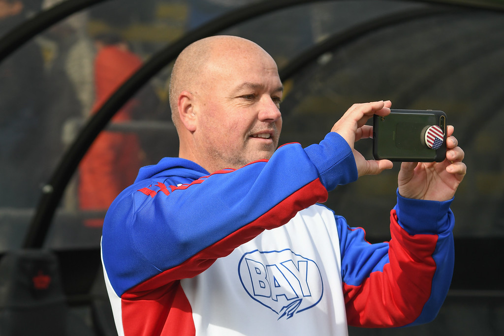 . Eric Bonzar�The Morning Journal<br> Bay head coach Bobby Dougherty takes photos of his team before the start of the D-II State Soccer Championship game against Columbus St. Francis DeSales, Nov. 11, 2017.