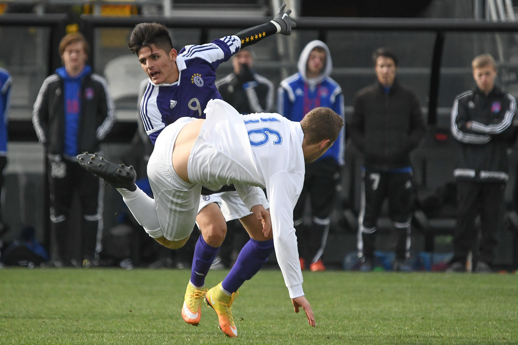 . Eric Bonzar�The Morning Journal<br> Bay midfielder Colin MacMillan (16) and St. Francis DeSales\' midfielder Cristian Gomez (9) get tangled up in the D-II State Soccer Championship game, Nov. 11, 2017.
