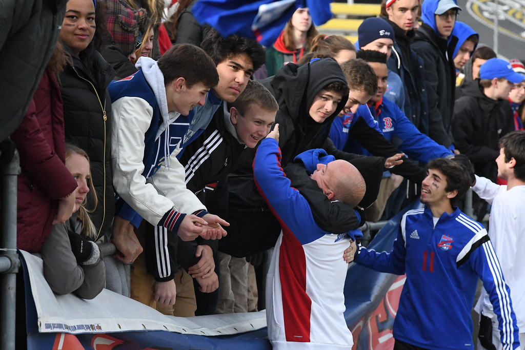 . Eric Bonzar�The Morning Journal Bay head coach Bobby Dougherty gets a hug from the student section after his team falls 4-0 to Columbus St. Francis DeSales in the D-II State Soccer Championship game, Nov. 11, 2017.
