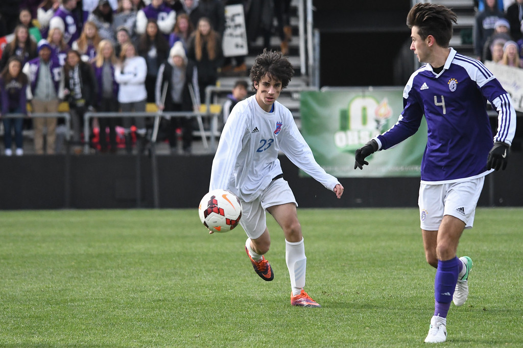 . Eric Bonzar�The Morning Journal<br> Bay midfielder Nico Saiz (23) chases down the ball as he\'s defended by Columbus St. Francis DeSales\' Zack Garrett (4) in the D-II State Soccer Championship game, Nov. 11, 2017.