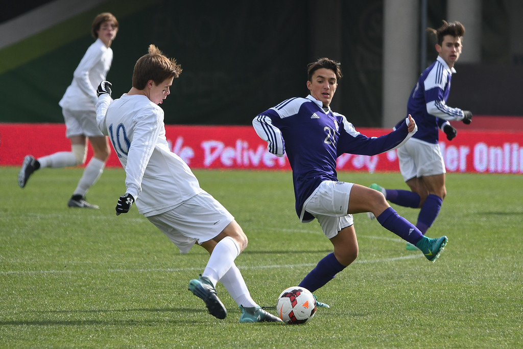 . Eric Bonzar�The Morning Journal<br> Bay midfielder Kyle Cusimano (10) moves the ball upfield past Columbus St. Francis DeSales\' midfielder Ricci Kreuzer (21) in the D-II State Soccer Championship game, Nov. 11, 2017.