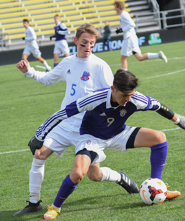 . Eric Bonzar�The Morning Journal<br> St. Francis DeSales forward Cristian Gomez (9) battles for the ball against Bay defender Jack Graham (5) in the D-II State Soccer Championship game, Nov. 11, 2017.