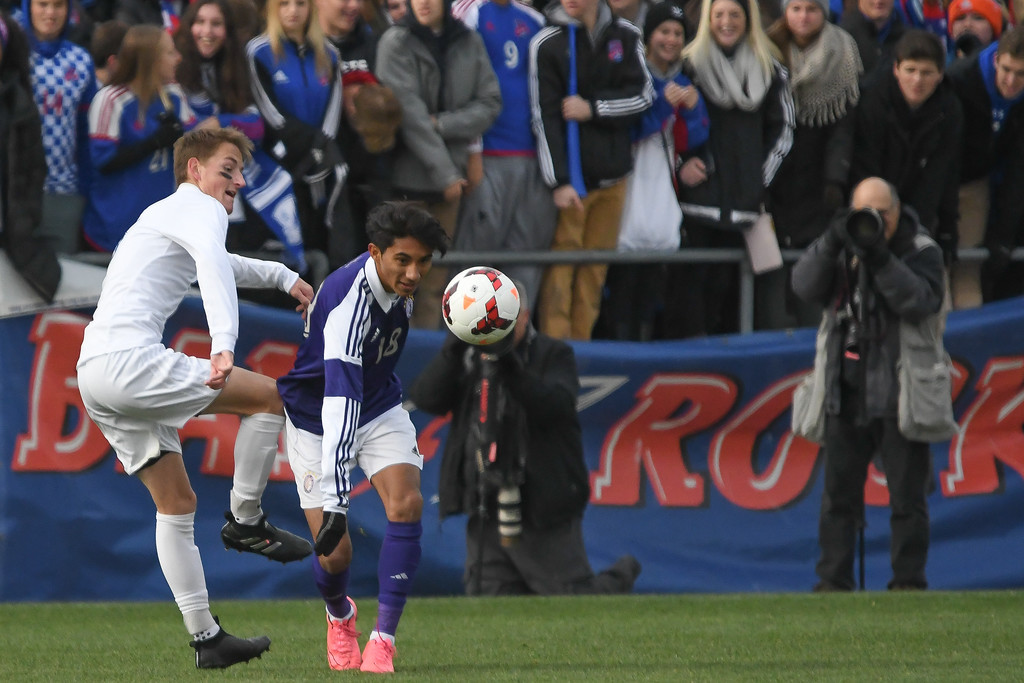 . Eric Bonzar�The Morning Journal<br> Bay defender Jack Graham (5) and Columbus St. Francis DeSales\' midfielder Cesar Ramirez (18) battle for the ball in the D-II State Soccer Championship game, Nov. 11, 2017.