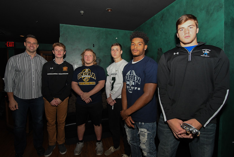 Eric Bonzar—The Morning Journal<br /> Former NFL linebacker and 2010 Super Bowl champion Matt Wilhelm, left, stands with the Morning Journal Sports' Matt Wilhelm Award Finalists Mark Pappas, Avon Lake quarterback, Olmsted Falls running back Spencer Linville, Westlake quarterback Trey Bialowas, Lorain running back/safety Carlos Chavis and winner Dustin Crum, quarterback for the Midview Middies, Nov. 15.