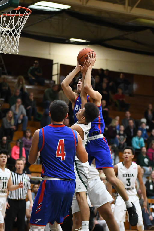 . Eric Bonzar�The Morning Journal<br> Bay\'s RJ Sunahara draws the and-one as he\'s fouled on his way to the basket by Elyria Catholic\'s Donovan Warfield.