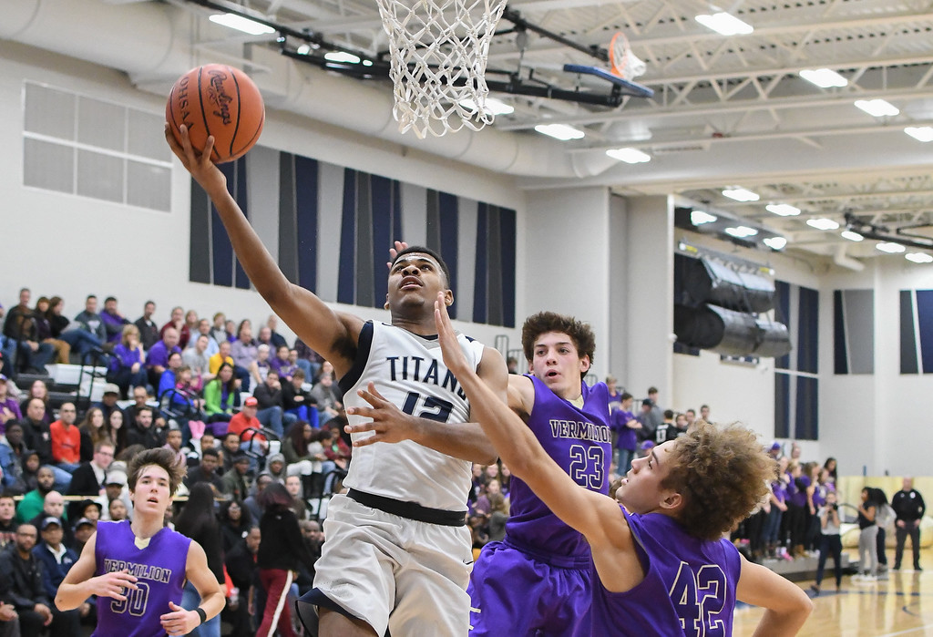 . Eric Bonzar�The Morning Journal Lorain guard Jalil Little had a game-high 21 points in the Titans\' 66-57 win over the Vermilion Sailors, Dec. 6, 2016.