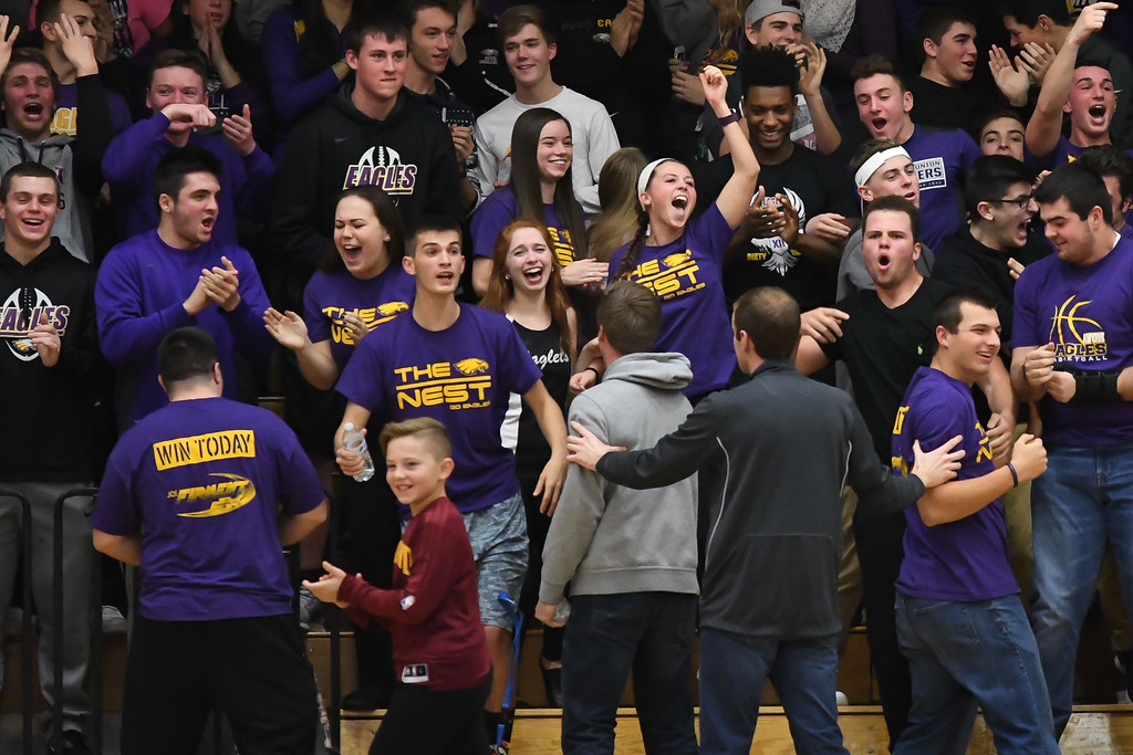 . Eric Bonzar�The Morning Journal The Avon Eagles nest erupts, during a time out, Dec. 9, 2016.