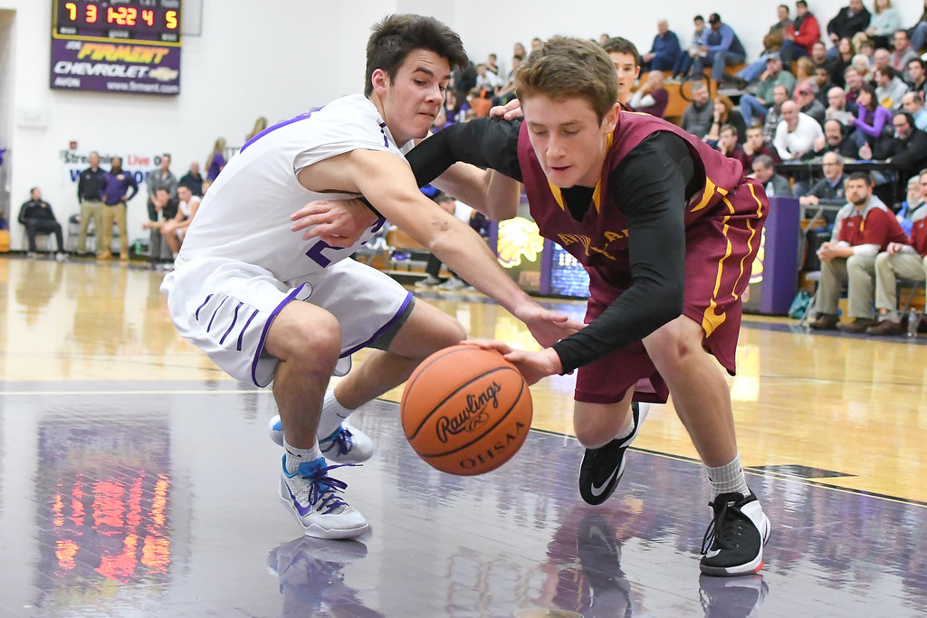 . Eric Bonzar�The Morning Journal Avon Lake\'s Mark Pappas (14) and Avon\'s Jake Parker (21) fight for a loose ball.