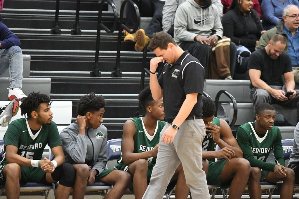 . Eric Bonzar�The Morning Journal<br> Bedford Bearcats head Coach Pete Priola grimaces as his team falls behind by more than 30 points in the second period, Dec. 15, 2017.
