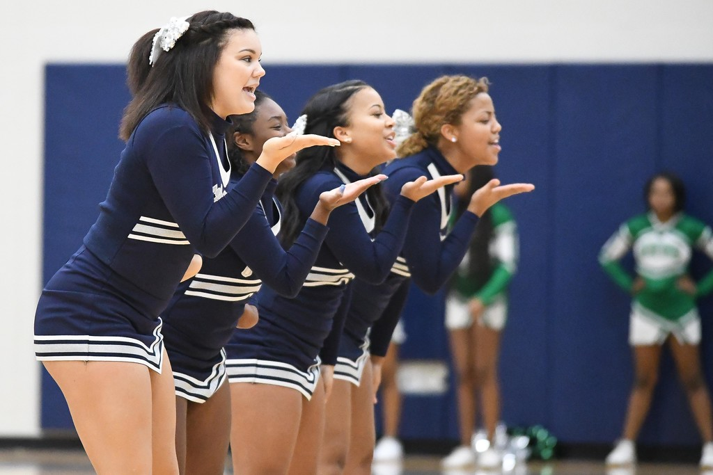 . Eric Bonzar�The Morning Journal<br> The Lorain Titans cheerleaders entertain the crowd during a timeout, Dec. 15, 2017.
