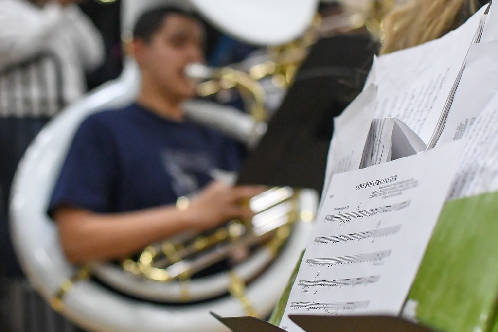 """. Eric Bonzar�The Morning Journal<br> The band gets the crowd warmed up with some \""""Love Roller Coaster,\"""" before the Titans\' game against the Bedford Bearcats, Dec. 15, 2017."""