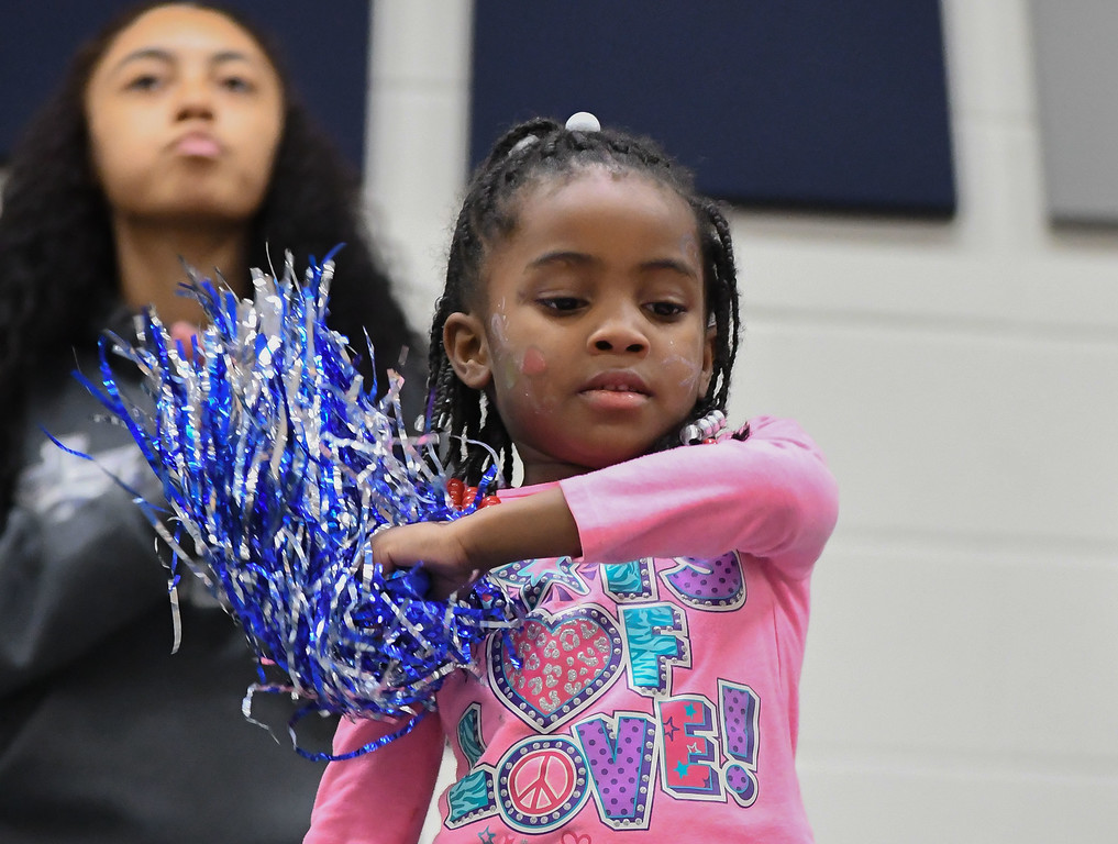 . Eric Bonzar�The Morning Journal<br> A young Titans fan dances along with the band, Dec. 15, 2017.
