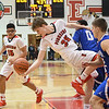 Eric Bonzar—The Morning Journal<br /> Elyria's Justin Koepp (35) reaches back for a rebound, Dec. 16, 2016.
