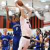 Eric Bonzar—The Morning Journal<br /> Elyria's Justin Koepp (35) is fouled on his way to the rim, Dec. 16, 2016.