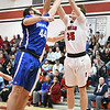 Eric Bonzar—The Morning Journal<br /> Brunswick's Zak Zografos (44) and Elyria's Justin Koepp (35), Dec. 16, 2016.