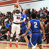 Eric Bonzar—The Morning Journal<br /> Elyria's Antonio Blanton (22) shoots over Brunswick's Kyle Goessler (1), Dec. 16, 2016.