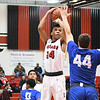 Eric Bonzar—The Morning Journal<br /> Elyria's Darquan Woods (24) pulls up a jump shot over Brunswick's Zak Zografos (44), Dec. 16, 2016.